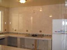 Resultado de imagen para cocina con arco y meson y for Modelos de gabinetes de cocina en concreto