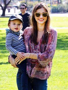 Look at those smiles! Miranda Kerr and her little boy Flynn enjoy some time outside. - People.com
