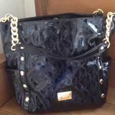 Mickel Kors Tote (XL) XL Black Michael Kors Tote with Gold adornments. Beautiful bag for the MK lover. Like New!  Only used once. Bought it at the Maxx for $199.  Depreciation value can be your good fortune. Michael Kors Bags Totes