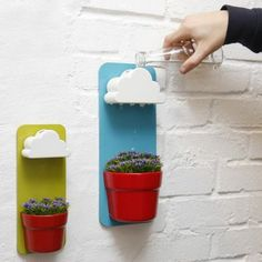 Rainy Pot by Seungbin Jeong These rad little hanging pots were designed by Korean designer Seungbin Jeong. These are perfect for people like...