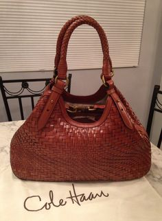 Cole Haan Genevieve Like New! Woven Leather Hobo Satchel Handbag Saddle Brown Cognac Tote Bag. Get one of the hottest styles of the season! The Cole Haan Genevieve Like New! Woven Leather Hobo Satchel Handbag Saddle Brown Cognac Tote Bag is a top 10 member favorite on Tradesy. Save on yours before they're sold out! GORGEOUS!!! LIKE NEW!!! BEAUTIFUL SADDLE BROWN/ COGNAC COLOR!!! SALE!!! FREE SHIPPING & NO TAX!!! WOW!!! IF YOU LOVE IT, GET IT, BECAUSE THIS GORGEOUS STYLE SELLS OUT FAST!!!