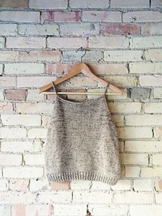 With a loose drape, deep armholes, and a cropped hem, the Beach Tank is a breeze to knit and wear.
