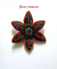 Lovely. This is a brooch but could easily be reworked as an ornament.