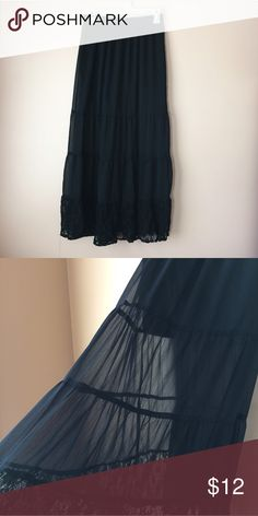 Xhileration Black Sheer Lace skirt Only worn a few times. Has a mini skirt under the sheer. Could fit a small as well Xhilaration Skirts Maxi