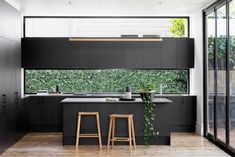 black kitchen, window splashback and window above overhead cabinetry Black Kitchens, Cool Kitchens, Kitchen Black, Charcoal Kitchen, Luxury Kitchens, Kitchen Living, New Kitchen, Asian Kitchen, Long Kitchen