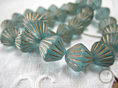 SAVE 10% use coupon code PIN10 Beautiful aqua blue African bicone beads. These Czech glass beads are accented with gold grooves and have a frosted matte finish and sparkle, what a beautiful focal or acce... #supplies #bead