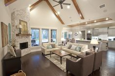 Living room opens up to kitchen.  Open concept home.  Wood beams and wood floor, McKinney Homes Custom Home.