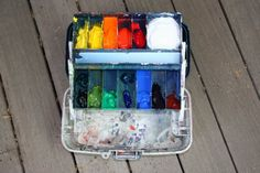 Marcia Burtt's site has great tips for plein aire acrylic painting equipment.  Pictured is a fishing tackle box with molded dividers -  Plano Model 6102 used as a plein aire paintbox