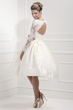 Would have to go to Birmingham to try this on -- 50's style T-Length dress with long lace sleeves and keyhole back. A stylish choice for the modern bride.  See this vintage inspired wedding dress on our real bride Laura