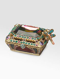 An elegant spot for tiny trinkets, handcrafted of rich enamel with a colorful hinged lid of faceted Swarovski crystals and a hovering dragonfly on the edge.