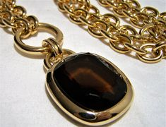 Vintage long Joan Rivers minimalist statement necklace 34 inch long chunky chain Faceted brown glass stone in gold tone setting, signed on back, 2 1/2 x 1 1/4 including bale Lobster claw clasp Signed on back of pendant Joan Rivers Very good vintage condition, shows no wear