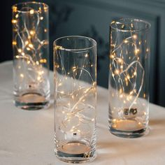 A unique light strand, each of the warm white LED micro, light bulbs are sprinkled across a thin, bendable silver wire. Battery-operated and. Lighted Centerpieces, Floral Centerpieces, Light Decorations, Wedding Centerpieces, Wedding Table, Wedding Decorations, Anniversary Party Centerpieces, Wedding Ideas, Rustic Wedding