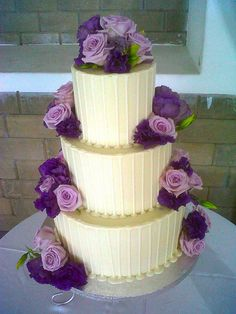 3-tier Wicked Chocolate Wedding cake iced in chocolate ganache with white chocolate drizzle decorated with purple roses & lisianthus by Charly's Bakery, via Flickr