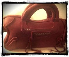 Balenciaga Style:   chocolate cake filled with apricot jam- dark chocolate ganache and coverd with sugarpaste