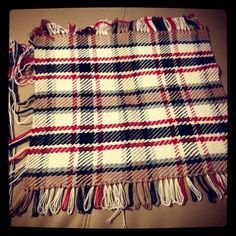 Hand woven plaid, created on a home-made picture frame loom.