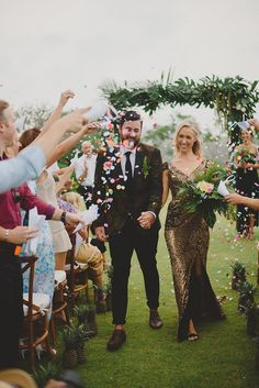 Bride's gold sequin sexy wedding dress and groom's palm print suit // Tropical Glamour: Nicholas and Skye's Wedding at the Istana, Bali