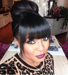 """Keisha Knight Pulliam •aka• """"Rudy"""" from The Cosby Show is working that high bun with bangs."""