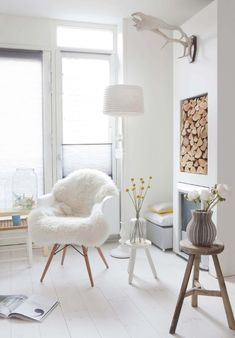 I'm obsessed with the fire wood being stored in the wall, and that chair !