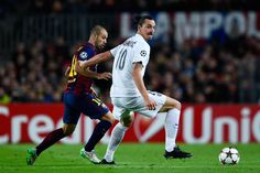 Zlatan Ibraimovic of Paris Saint-Germain FC competes for the ball with Javier Mascherano of FC Barcelona during prior to the UEFA Champions League group F match between FC Barcelona and Paris Saint-Germanin FC at Camp Nou Stadium on December 10, 2014 in Barcelona, Catalonia.