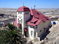 """Goerke Haus one of the """"diamond palaces"""" of Luderitz, Namibia, was home to Hans Goerke, manager and co-owner of the German-era diamond mining company. Namibia, Mansions, House Styles, Places, Travel, Home Decor, House, Viajes, Decoration Home"""