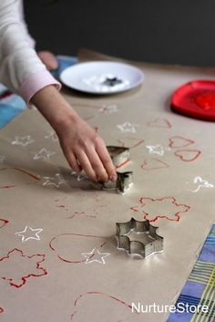 """Cookie cutter """"stamps"""" dipped in spice-infused paint create a fun, fragrant pattern to a roll of kraft paper, making this a great DIY to do with kids. See more at NurtureStore »"""