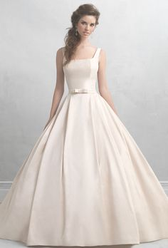 Madison James. If ever there was a gown that embodied sweetness, it's this creamy satin ballgown. Its only ornamentation is a small bow at the waist, while the square neckline leads to a scooped back.