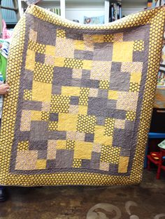 gray and yellow quilt