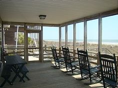 Screen Porch...love the rocking chairs:)