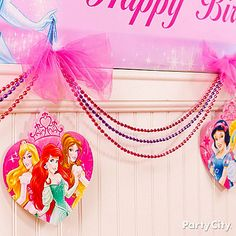 Dress up the *ballroom* with glam DIY garlands! Click for deets on how to make it, plus a castle-ful of easy Disney Princess party ideas!