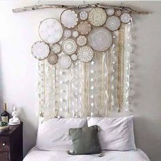 Wonderfully Dreamy Wall Decor! Use some doilies/lace inside different size embroidery hoops, dangle some streamers of trim, ribbon, fabrics and lace and hang from a tree branch!