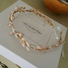 Erica Elizabeth ringlet circlet head piece Gold ringlet with pearls and light pink accents. I wore it one day for my wedding. It's stunning. Erica Elizabeth designs Jewelry