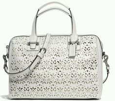 Coach Taylor Eyelet leather Satchel $498 NWT. I have this one.