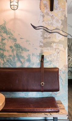 leather back on the wall to make a bench more comfortable