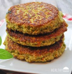 Veggie Burgers | Healthy Recipes Blog 1 medium onion, quartered 1 cup shredded carrots 1/2 cup fresh cilantro 1 (15oz) can cannellini beans 3 large eggs 1/4 cup plain low fat Greek yogurt 1 teaspoon kosher salt 1 teaspoon ground cumin 1 tablespoon minced garlic 1/4 teaspoon cayenne pepper 2 cups quick cooking oats 4 tablespoons olive oil
