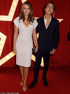 Looking good:Elizabeth Hurley, 52, showcased her toned legs and cleavage in a statement i...