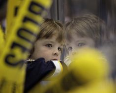 APRIL 28: A young St. Louis Blues watches intently in Game One of the Western Conference Semifinals between the St. Louis Blues and the Los Angeles Kings during the 2012 NHL Stanley Cup Playoffs at Scottrade Center on April 28, 2012 in St. Louis, Missouri. (Photo by Mark Buckner/NHLI via Getty Images)