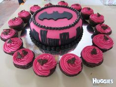 ZThis is a choc cake with butter cream then fondant icing on top. My second daughter just loves 'boys' things and asked for batman, she was super happy with the end result - great inclusion of boy meets girl. Cupcakes are choc cake with pink butter cream icing and little choc bats on top.