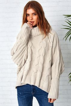 Step inside your comfort zone. Product Code: CMY193 Details: Turtle neck Hollow design Twist knitting High low design Casual style Regular wash Fabric:100%Cot
