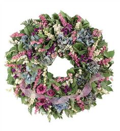 Spring Everyday Wreath with pink, purple and blue botanicals topped with a pretty pink ribbon.
