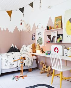 Love the mountains painted on the wall of this kids room. Colorful but calming palette.