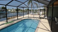 Solar Heated Pool that is part of a large outside porch & entertainment area.
