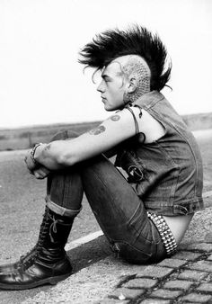 80's punk.  Mohawk, tattoos, Dr.Marteens, studded belt and bracelet.
