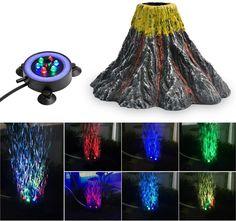 Er besteht aus ungiftigen, für Ihre Fische und Pflanzen völlig sicheren Harzen, die das biologische Gleichgewicht des Aquariums nicht beeinflussen. Farbigen Luftblasen versorgen Ihre Wasserpflanzen und Fische mit Sauerstoff. In Kombination mit dem farbigen LED ergibt dies spektakuläre Lichteffekte. Schönes Dekorationselement für Ihr heimisches Unterwasserparadies. Lieferinhalt: 1 * Harzvulkanverzierung, 1 * RGB LED-Licht, 1 * Netzteil, 1 * Luftstein. (Luftpumpe Nicht Inbegriffen) Rgb Led, Aquarium Decorations, Tanked Aquariums, Led Licht, Volcano, Fish Tank, Pet Supplies, Bubbles, Kit
