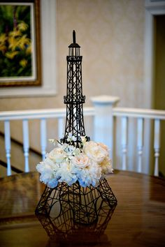 Wire Eiffel Tower with flowers! Great bridal shower idea!