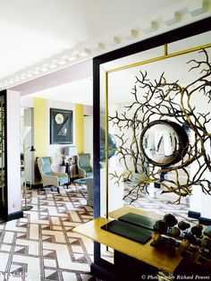 A mirror attached to a mirrored wall makes for a reflective interior moment in a Paris apartment designed by Baroness Bruno de Pampelonne. From 'Paris in Pastel', a story on page 168 of Vogue Living July/Aug 2010. Photograph by Richard Powers.