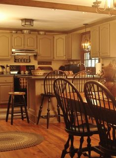 Love the color of the cabinets in this country kitchen!