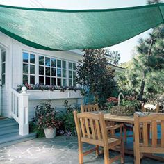 """Triangle Shade Sail - Reduce cooling bills and prevent sun damage with eezy, Coolaroo faic. An oasis of cooling, UV-protected shade. The Coolaroo Shade Sail lets you enjoy a """"covered porch"""" all summer long no building or costly installation. Outdoor Shade, Patio Shade, Pergola Shade, Backyard Shade, Pergola Patio, White Pergola, Cheap Pergola, Coolaroo Shade Sail, Gardens"""