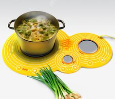 Flexible and highly portable, the Cooka mat uses silver's conductive properties to create a fast-heating cooking surface with three burners. The mat cools down as fast as it heats up, and can be rolled up and stowed away when not in use.