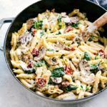 A (Lighter) Creamy Penne Chicken Pasta Dish with mushrooms, spinach, and sun-dried tomatoes. Easy, 30-minute dinner that can be made in ONE pot!