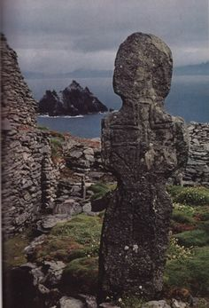Relic of a saintly age, a stone marker wears the outline of a Latin cross, carved more than a thousand years ago by Irish monks on a storm swept Skellig Michael. Skellig Michael is an island off the kerry coast of Ireland.